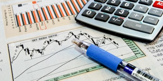 8801484-calculator-and-pen-on-business-newspaper-showing-chart-and-graph-background-Stock-Photo